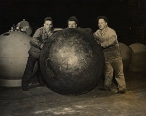 Men Rolling a Gas Canister