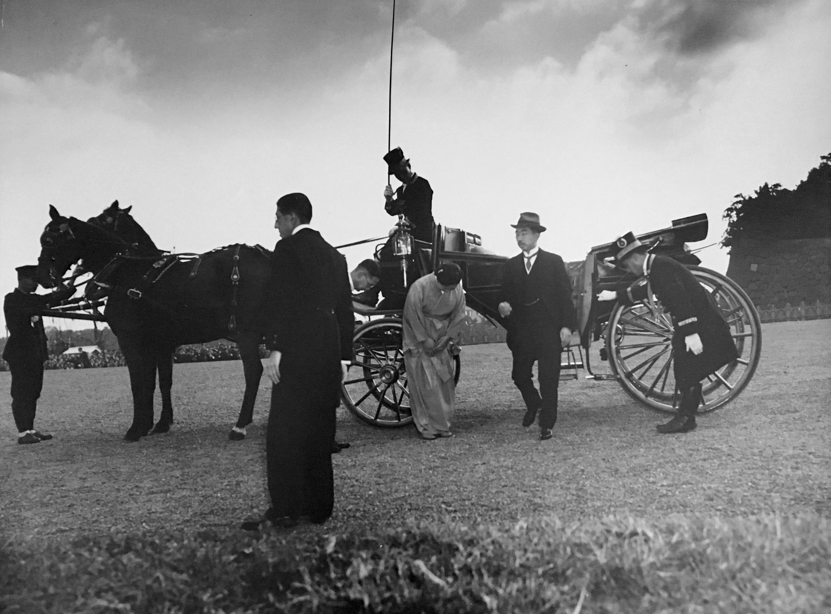 Emperor Hirohito and Empress Nagako en Route to Reviewing Stand (Leaving Their Ceremonial Coach)