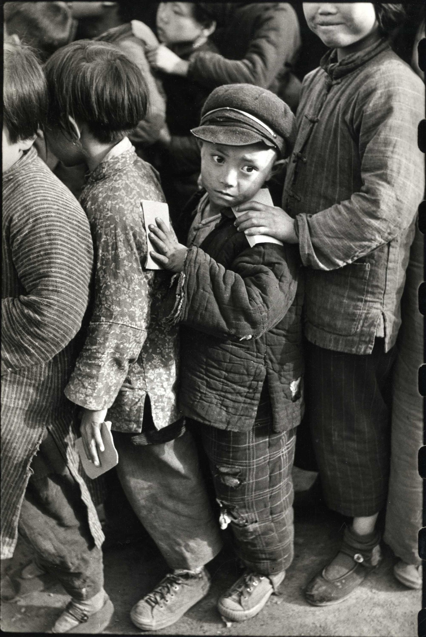 �Les petits professeurs� lining up for rice, China, 1948-49