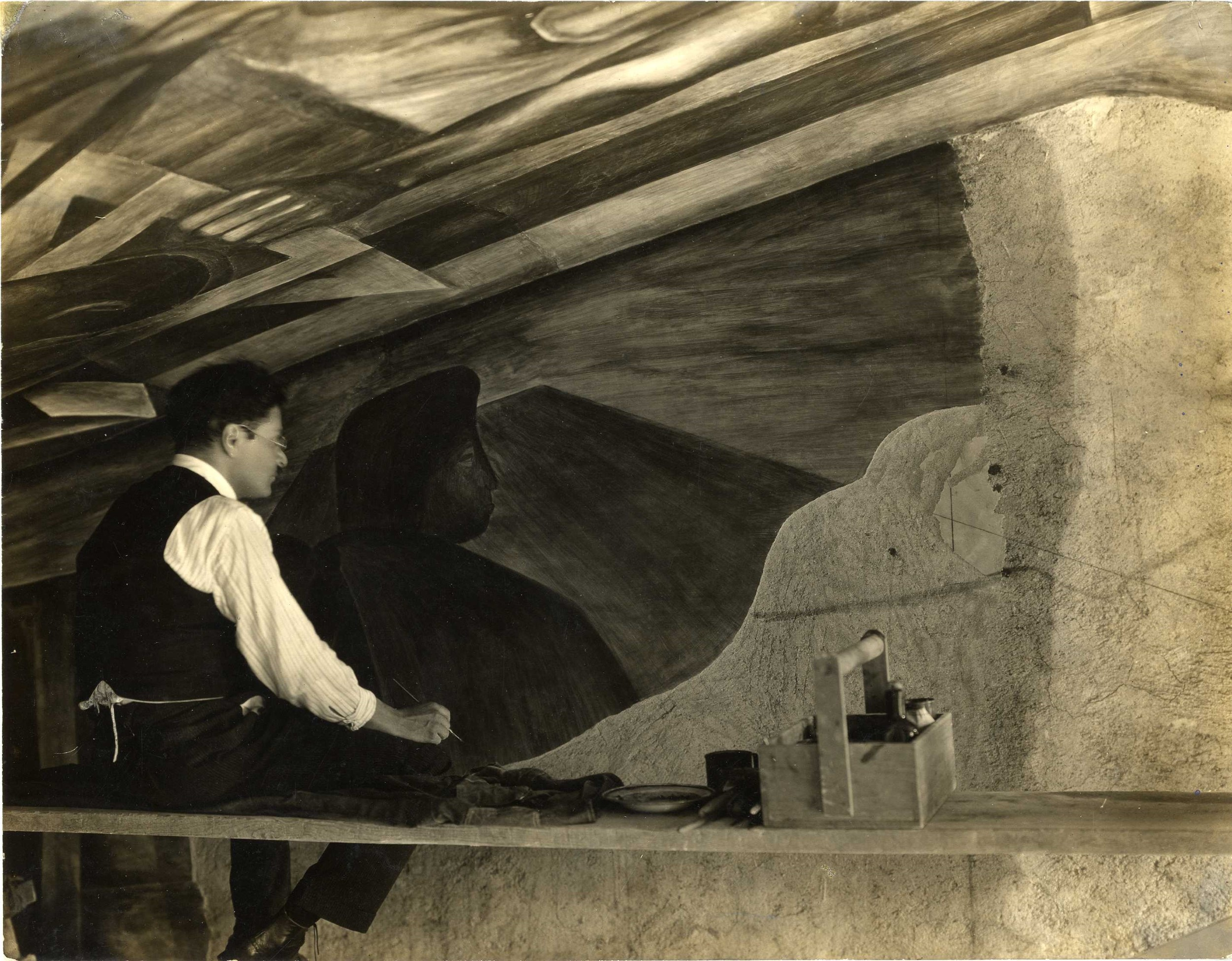 Jos� Clemente Orozco at work on a mural, 1927