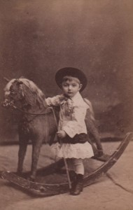 Portrait of young girl and rocking horse