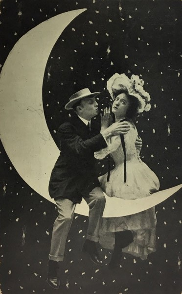 Embracing Couple on Paper Moon