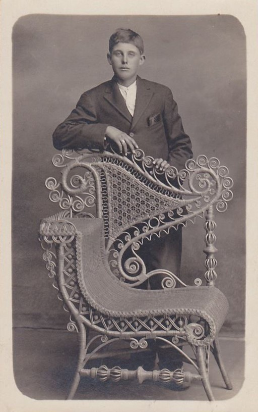Young Man With Beautiful Wicker Chair